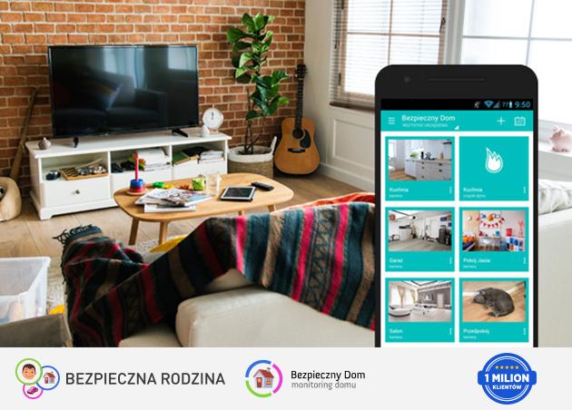 salon mieszkania z telewizorem i gitarą oraz usługą bezpieczny dom